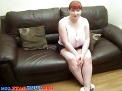 Amateur redhead plays with her tits